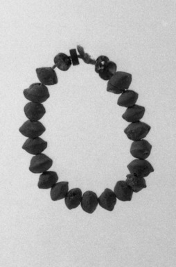 <em>String of 23 Beads</em>, ca. 4400–3100 B.C. Clay, diorite, Approximate length: 3 7/16 in. (8.8 cm). Brooklyn Museum, Charles Edwin Wilbour Fund, 07.447.765. Creative Commons-BY (Photo: Brooklyn Museum, 07.447.765_bw.jpg)