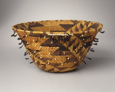 Jenny Hughes (Pomo). <em>Girl's Coiled Dowry or Puberty Basket (kol-chu or ti-ri-bu-ku)</em>, late 19th century. Willow, sedge root, bulrush root, black quail topknots, red woodpecker crest feathers, Olivella shell beads, cotton string, 7 × 14 1/2 × 14 1/2 in. (17.8 × 36.8 × 36.8 cm). Brooklyn Museum, Museum Expedition 1907, Museum Collection Fund, 07.467.8308. Creative Commons-BY (Photo: Brooklyn Museum, 07.467.8308_SL1.jpg)