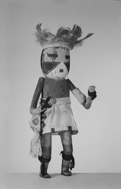 She-we-na (Zuni Pueblo). <em>Kachina Doll (Eka Ya Tosh Na-kwe)</em>, late 19th century. Wood, cloth, hide, feathers, string, pigment, wool, 14 3/8 x 5 7/8 x 3 7/8 in. (36.5 x 14.9 x 9.8 cm). Brooklyn Museum, Museum Expedition 1907, Museum Collection Fund, 07.467.8396. Creative Commons-BY (Photo: Brooklyn Museum, 07.467.8396_acetate_bw.jpg)