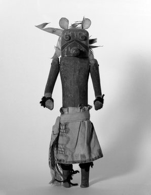 She-we-na (Zuni Pueblo). <em>Kachina Doll (May-Kjappa)</em>, late 19th century. Wood, pigment, hide, feather, cotton, wool, 14 x 4 3/4 x 3 7/8 in. (35.6 x 12.1 x 9.8 cm). Brooklyn Museum, Museum Expedition 1907, Museum Collection Fund, 07.467.8399. Creative Commons-BY (Photo: Brooklyn Museum, 07.467.8399_bw.jpg)