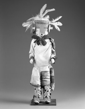 She-we-na (Zuni Pueblo). <em>Kachina Doll (Thleakwah)</em>, late 19th century. Wood,pigment, textile, string, yarn, hide, feathers, 19 13/16 x 5 13/16 x 4 7/16 in. (50.3 x 14.8 x 11.3 cm). Brooklyn Museum, Museum Expedition 1907, Museum Collection Fund, 07.467.8419. Creative Commons-BY (Photo: Brooklyn Museum, 07.467.8419_bw.jpg)
