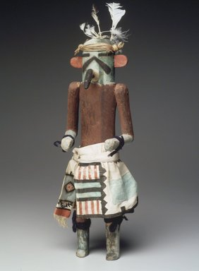 She-we-na (Zuni Pueblo). <em>Kachina Doll (Kja-kja-lih)</em>, late 19th century. Wood, feather, cotton, pigment, wool yarn, plant fiber, 14 15/16 x 4 13/16 x 4 3/16 in. (37.9 x 12.2 x 10.6 cm). Brooklyn Museum, Museum Expedition 1907, Museum Collection Fund, 07.467.8425. Creative Commons-BY (Photo: Brooklyn Museum, 07.467.8425.jpg)