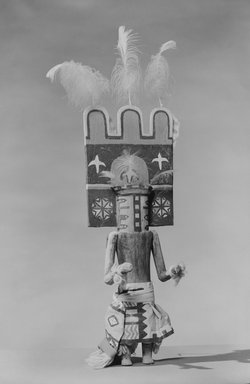 She-we-na (Zuni Pueblo). <em>Kachina Doll (Homshekwah)</em>, late 19th century. Wood, pigment, feathers, leather, metal, wool yarn, cotton, 21 x 6 3/8 x 3 in. (53.3 x 16.2 x 7.6 cm). Brooklyn Museum, Museum Expedition 1907, Museum Collection Fund, 07.467.8427. Creative Commons-BY (Photo: Brooklyn Museum, 07.467.8427_acetate_bw.jpg)