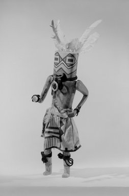 She-we-na (Zuni Pueblo). <em>Kachina Doll (Tsekohpastih)</em>, late 19th century. Wood, feather, cotton, wool, pigment, plant fiber, 15 x 4 5/8 x 5 in. (38.1 x 11.7 x 12.7 cm). Brooklyn Museum, Museum Expedition 1907, Museum Collection Fund, 07.467.8439. Creative Commons-BY (Photo: Brooklyn Museum, 07.467.8439_acetate_bw.jpg)