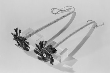 Pomo. <em>Pair of Incised and Decorated Ear Bones</em>, late 19th century. Bone, feathers,clamshell, plant fiber, cotton string, pigment, 7 7/8 x 2 3/4 in. (20 x 7 cm). Brooklyn Museum, Museum Expedition 1907, Museum Collection Fund, 07.467.8575a-b. Creative Commons-BY (Photo: Brooklyn Museum, 07.467.8575a-b_acetate_bw.jpg)