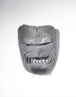 Coast Salish. <em>Carved Human Mask</em>, late 19th century. Wood, metal nail, hide, fur, hair, 8 1/4 x 6 1/2 x 3 15/16in. (21 x 16.5 x 10cm). Brooklyn Museum, By exchange, 07.468.9382. Creative Commons-BY (Photo: Brooklyn Museum, 07.468.9382_bw_SL5.jpg)
