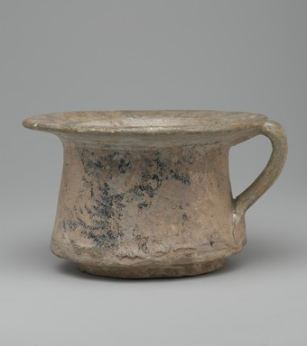 <em>Cup</em>, 13th century. Ceramic; fritware, painted in black and cobalt blue under a transparent glaze; heavy iridescence; rim and handle repaired, 4 x 6 7/8 in. (10.2 x 17.5 cm). Brooklyn Museum, Museum Collection Fund, 08.23. Creative Commons-BY (Photo: Brooklyn Museum, 08.23_side1_PS2.jpg)