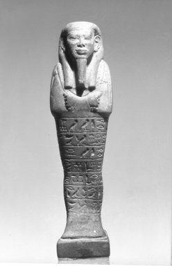 <em>Shabty of Ptahnufer</em>, 664-332 B.C.E. Faience, 4 3/8 x  width at elbows 1 1/8 in. (11.1 x 2.9 cm). Brooklyn Museum, Charles Edwin Wilbour Fund, 08.480.11. Creative Commons-BY (Photo: Brooklyn Museum, 08.480.11_front_bw.jpg)