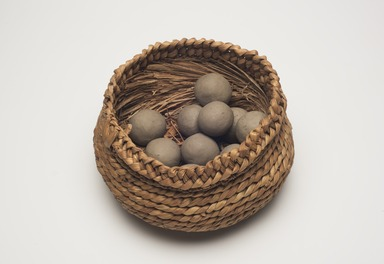 Pen Graves (Pomo). <em>10 Balls used for Killing Marsh Hens  (ta-ma-whille)</em>, ca. 1906. Clay, plant fiber, Diameter: 1 1/2 in. (3.8 cm). Brooklyn Museum, Museum Expedition 1908, Museum Collection Fund, 08.491.8581. Creative Commons-BY (Photo: Brooklyn Museum, 08.491.8612_0.491.8581_PS11.jpg)