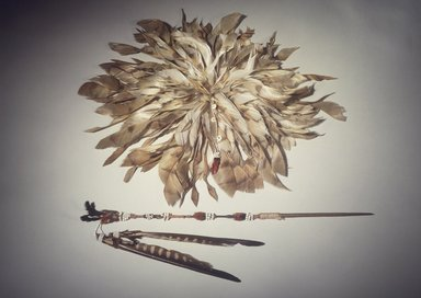 George Barber (Maidu, 1833-1918). <em>Head Plume (Wai-yet-ti)</em>, late 19th-early 20th century. Barn owl feathers, acorn woodpecker scalp, clamshell beads, glass beads, cotton string, 3 1/8 x 13 3/4 in. (7.9 x 34.9 cm). Brooklyn Museum, Museum Expedition 1908, Museum Collection Fund, 08.491.8807. Creative Commons-BY (Photo: , 08.491.8802_08.491.8807.jpg)
