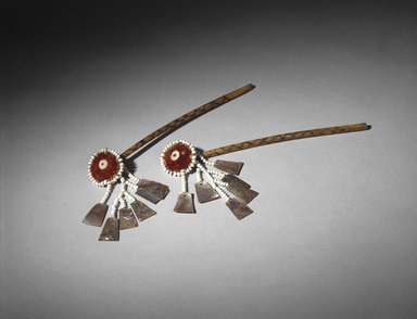 Mary Kea'a'ala Azbill (Maidu, 1864-1932). <em>Ear Bones (Bo-no)</em>, late 19th-early 20th century. Crane wing bones, sedge root, acorn woodpecker scalp, feathers, glass beads, commercial string, abalone shell, 9 x 1 1/2 in. (22.9 x 3.8 cm). Brooklyn Museum, Museum Expedition 1908, Museum Collection Fund, 08.491.8826a-b. Creative Commons-BY (Photo: Brooklyn Museum, 08.491.8826a-b_SL1.jpg)