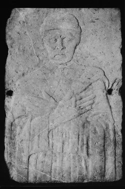 Italian. <em>Carved Tomb Slab.  Relief, half-length portrait of beardless manwith eyes closed, hands crossed on breast.</em>, 15th century. Stone, 37 x 25 1/4 x 6 in. (94 x 64.1 x 15.2 cm). Brooklyn Museum, Gift of A. Augustus Healy, 09.795. Creative Commons-BY (Photo: Brooklyn Museum, 09.795_acetate_bw.jpg)