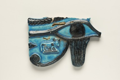 <em>Wadjet-eye Amulet</em>, 664–332 B.C.E. Faience, 3 1/2 x 5 1/8 x 9/16 in. (8.9 x 13 x 1.4 cm). Brooklyn Museum, Museum Collection Fund, 09.877. Creative Commons-BY (Photo: Brooklyn Museum, 09.877_PS11.jpg)