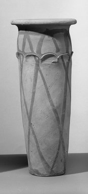<em>Wavy-Handled Cylindrical Vase</em>, ca. 3100-2675 B.C.E. Terracotta, pigment, 10 3/8 x Greatest Diam. 4 7/16 in. (26.4 x 11.3 cm). Brooklyn Museum, Charles Edwin Wilbour Fund, 09.889.718. Creative Commons-BY (Photo: Brooklyn Museum, 09.889.718_bw.jpg)