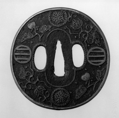 <em>Sword Guard</em>, 17th century. Iron with brass inlay; copper sekigane, 3 1/4 x 3 1/8 in. (8.2 x 8 cm). Brooklyn Museum, Museum Expedition 1909, Purchased with funds given by Thomas T. Barr, E. LeGrand Beers, Carll H. de Silver, Herman B. Stutzer, Colonel Robert B. Woodward and the Museum Collection Fund, 09.915.13. Creative Commons-BY (Photo: Brooklyn Museum, 09.915.13_front_bw.jpg)