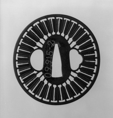 <em>Sword Guard</em>, 18th-19th century. Iron, copper, 2 15/16 x 2 13/16 in. (7.5 x 7.1 cm). Brooklyn Museum, Museum Expedition 1909, Purchased with funds given by Thomas T. Barr, E. LeGrand Beers, Carll H. de Silver, Herman B. Stutzer, Colonel Robert B. Woodward and the Museum Collection Fund, 09.915.2. Creative Commons-BY (Photo: Brooklyn Museum, 09.915.2_front_bw.jpg)