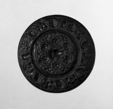 <em>Small Circular Mirror</em>, 618-906. Bronze, diameter: 3 1/8 in. (7.9 cm). Brooklyn Museum, Museum Expedition 1909, Purchased with funds given by Thomas T. Barr, E. LeGrand Beers, Carll H. de Silver, Herman B. Stutzer, Colonel Robert B. Woodward and the Museum Collection Fund, 10.61. Creative Commons-BY (Photo: Brooklyn Museum, 10.61_bw.jpg)