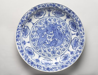 <em>Dish Depicting a Coiled Dragon</em>, late 17th century. Ceramic; stone paste, painted in cobalt blue under a transparent colorless glaze, Diam. 16 5/16 in. (41.4 cm). Brooklyn Museum, Museum Collection Fund, 11.33. Creative Commons-BY (Photo: Brooklyn Museum, 11.33_PS9.jpg)