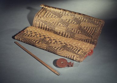 Osage. <em>Medicine Bag with Pipe</em>, late 19th-early 20th century. Rush, native dyes, red wool, catlinite, wood (ash), Pipe: 4 1/2 x 3 in. Brooklyn Museum, Museum Expedition 1911, Museum Collection Fund, 11.694.9043a-c. Creative Commons-BY (Photo: Brooklyn Museum, 11.694.9043a-c.jpg)