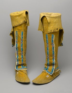 Osage, Comanche. <em>Pair of Women's Moccasins Attached to Leggings</em>, early 20th century. Hide, pigment, glass beads, sinew, fur, 24 1/2 x 3 1/4 x 9 1/2 in. (62.2 x 8.3 x 24.1 cm). Brooklyn Museum, Museum Expedition 1911, Museum Collection Fund, 11.694.9055a-b. Creative Commons-BY (Photo: Brooklyn Museum, 11.694.9055a-b_PS2.jpg)