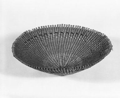 Possibly Pomo. <em>Sifter Basket</em>. Fiber, (12.0 x 30.7 cm). Brooklyn Museum, Museum Expedition 1911, Museum Collection Fund, 11.694.9161. Creative Commons-BY (Photo: Brooklyn Museum, 11.694.9161_view2_bw_SL5.jpg)