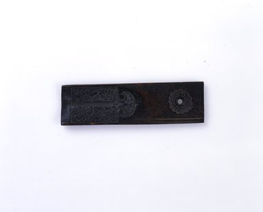 Ainu. <em>Carved Loom Separator (Mold)</em>. Wood, 2 3/16 x 3 3/8 in. (5.5 x 8.5 cm). Brooklyn Museum, Gift of Herman Stutzer, 12.174. Creative Commons-BY (Photo: , 12.174_Ainu_project.jpg)
