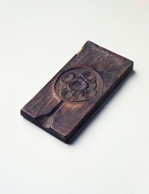 Ainu. <em>Carved Mold</em>. Wood, 2 3/16 x 4 9/16 in. (5.5 x 11.6 cm). Brooklyn Museum, Gift of Herman Stutzer, 12.175. Creative Commons-BY (Photo: , 12.175.jpg)