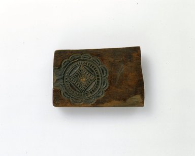 Ainu. <em>Carved Mold</em>. Wood, 1 15/16 x 3 1/4 in. (5 x 8.3 cm). Brooklyn Museum, Gift of Herman Stutzer, 12.176. Creative Commons-BY (Photo: North American Ainu Documentation Project, Yoshiburo Kotani, 1990-92, 12.176_view1_Ainu_project.jpg)