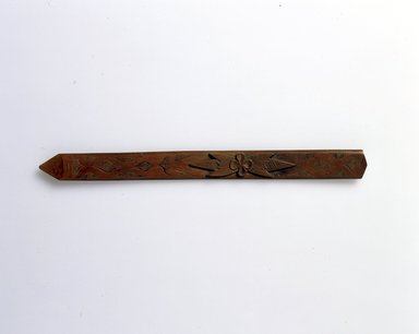 Ainu. <em>Long Rather Wide Prayer Stick</em>. Wood, 1 1/4 x 13 11/16 in. (3.2 x 34.8 cm). Brooklyn Museum, Gift of Herman Stutzer, 12.261. Creative Commons-BY (Photo: North American Ainu Documentation Project, Yoshiburo Kotani, 1990-92, 12.261_Ainu_project.jpg)