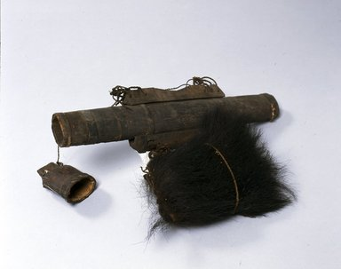 Ainu. <em>Long Quiver with Arrows</em>. Bark and wood, 1 1/2 x 4 15/16 x 16 15/16 in. (3.8 x 12.5 x 43.1 cm). Brooklyn Museum, Gift of Herman Stutzer, 12.397. Creative Commons-BY (Photo: North American Ainu Documentation Project, Yoshiburo Kotani, 1990-92, 12.397_Ainu_project.jpg)