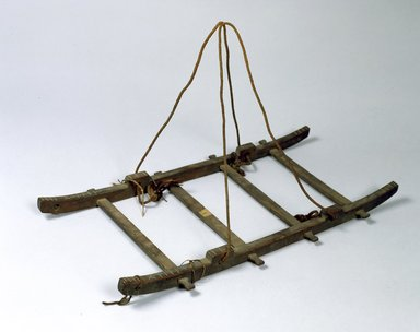 Ainu. <em>Cradle Frame</em>. Wood, 1 5/8 x 11 1/16 x 25 3/8 in. (4.2 x 28.1 x 64.4 cm). Brooklyn Museum, Gift of Herman Stutzer, 12.444. Creative Commons-BY (Photo: North American Ainu Documentation Project, Yoshiburo Kotani, 1990-92, 12.444_Ainu_project.jpg)
