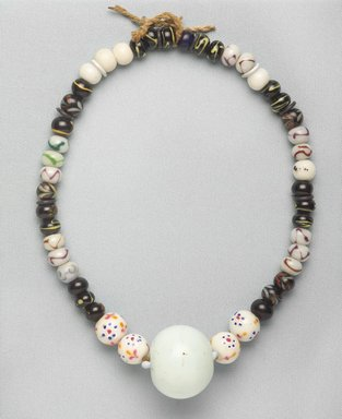 Ainu. <em>Necklace</em>. Beads, 1 3/8 x 20 1/2 in. (3.5 x 52 cm). Brooklyn Museum, Gift of Herman Stutzer, 12.447. Creative Commons-BY (Photo: Brooklyn Museum, 12.447_PS9.jpg)