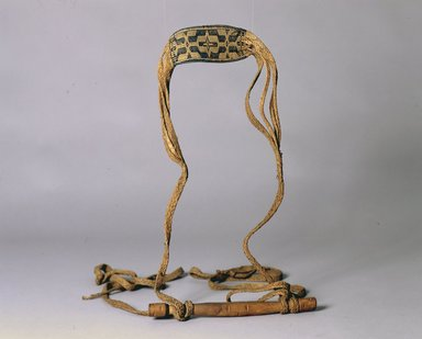 Ainu. <em>Baby Sling</em>. Flat plaited grass baby sling.  Broad band at center with black geometric decoration.  Long wooden handle sling attached to each end of handle.