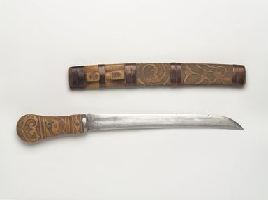 Ainu. <em>Sword with Carved Handle</em>, late 19th-early 20th century. Wood and steel, knife in sheath: 1 9/16 x 1 1/2 x 19 7/8 in. (4 x 3.8 x 50.5 cm). Brooklyn Museum, Gift of Herman Stutzer, 12.497a-b. Creative Commons-BY (Photo: Brooklyn Museum, 12.497_PS9.jpg)
