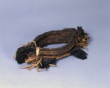 Ainu. <em>Crown</em>. Cloth, bear claws, 2 15/16 x 15 9/16 in. (7.5 x 39.5 cm). Brooklyn Museum, Gift of Herman Stutzer, 12.581. Creative Commons-BY (Photo: , 12.581_Ainu_project.jpg)