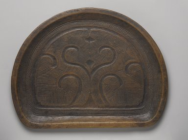 Ainu. <em>Carved Tray</em>, late 19th-early 20th century. Wood, 13/16 x 12 3/4 x 9 7/8 in. (2.1 x 32.4 x 25.1 cm). Brooklyn Museum, Gift of Herman Stutzer, 12.669. Creative Commons-BY (Photo: Brooklyn Museum, 12.669_PS9.jpg)