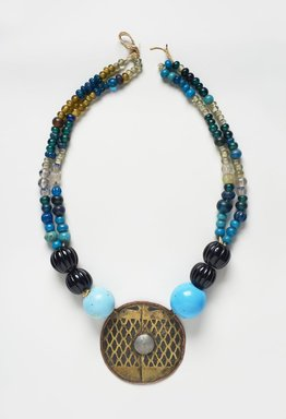 Ainu. <em>Woman's Necklace</em>, late 19th-early 20th century. Brass, different kinds of beads, metal wire, and cotton ribbon, 11 1/8 × 1 5/8 × 15 1/2 in. (28.3 × 4.1 × 39.4 cm). Brooklyn Museum, Gift of Herman Stutzer, 12.738. Creative Commons-BY (Photo: Brooklyn Museum, 12.738_PS11.jpg)