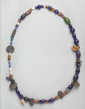 Ainu. <em>Necklace</em>, late 19th - early 20th century. Beads, thimble, shells, coins, 5/8 x 36 1/4 in. (1.6 x 92 cm). Brooklyn Museum, Gift of Herman Stutzer, 12.809. Creative Commons-BY (Photo: Brooklyn Museum, 12.809_PS9.jpg)
