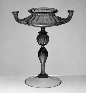<em>Double Oil Lamp</em>. Smoky glass, body diameter: 3 3/4 in. Brooklyn Museum, Museum Special Fund, 13.1080.40a-b. Creative Commons-BY (Photo: Brooklyn Museum, 13.1080.40a-b_acetate_bw.jpg)