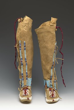 Possibly Cheyenne. <em>Child's Pair of Beaded Moccasins</em>, late 19th or early 20th century. Hide, beads, a: 14 x 2 1/2 x 6 in. (35.6 x 6.4 x 15.2 cm). Brooklyn Museum, Brooklyn Museum Collection, 13.15a-b. Creative Commons-BY (Photo: Brooklyn Museum, 13.15a-b_view1_PS2.jpg)