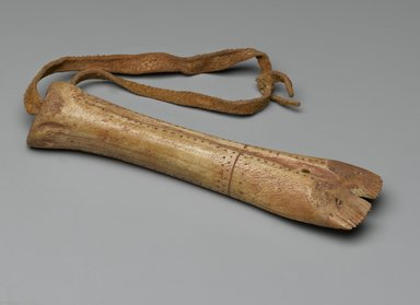 Plains. <em>Hide Scraper</em>, 18th century. Bone, red pigment, hide, 8 11/16 x 2 3/8 in. (22 x 6 cm). Brooklyn Museum, Brooklyn Museum Collection, 13.17. Creative Commons-BY (Photo: Brooklyn Museum, 13.17_PS2.jpg)