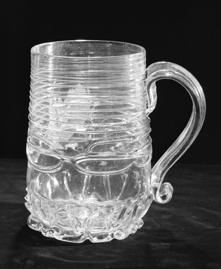 <em>Molded Mug with Handle</em>, ca. 1690. Glass, 6 1/8 x 3 3/4 in. (15.6 x 9.5 cm). Brooklyn Museum, Purchased by Special Subscription and Museum Collection Fund, 13.707. Creative Commons-BY (Photo: Brooklyn Museum, 13.707_acetate_bw.jpg)