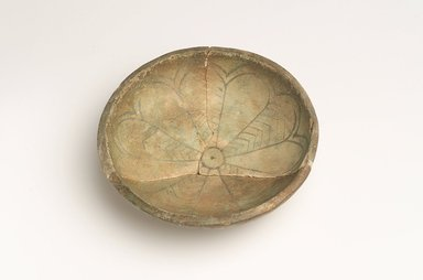 <em>Dish</em>, ca. 1539-1292 B.C.E. Faience, 1 1/16 × 3/16 × 4 1/8 in. (2.7 × 0.4 × 10.5 cm). Brooklyn Museum, Gift of the Egypt Exploration Fund, 14.612. Creative Commons-BY (Photo: Brooklyn Museum, 14.612_view4.jpg)