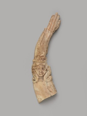"<em>Fragment of a ""Magic Wand"" or Clapper</em>, ca. 1539-1292 B.C.E. Ivory, 1 5/16 x 5 5/16 in. (3.3 x 13.5 cm). Brooklyn Museum, Gift of the Egypt Exploration Fund
