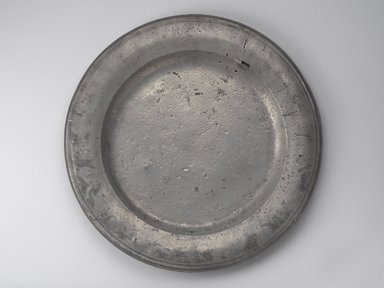 American. <em>Large Platter</em>, early 18th century. Pewter, 1/2 x 20 5/8 x 20 5/8 in. (1.3 x 52.4 x 52.4 cm). Brooklyn Museum, Gift of Luke Vincent Lockwood, 14.678. Creative Commons-BY (Photo: Brooklyn Museum, 14.678.jpg)