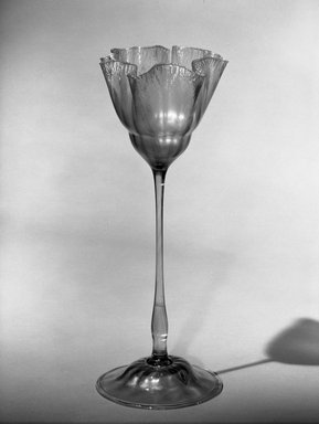 Tiffany & Company (American, founded 1853). <em>Flower Vase</em>, ca. 1896-1900. Favrile glass, 13 3/4 x 5 1/4 x 5 1/4 in. (34.9 x 13.3 x 13.3 cm). Brooklyn Museum, Gift of Charles W. Gould, 14.739.11. Creative Commons-BY (Photo: Brooklyn Museum, 14.739.11_acetate_bw.jpg)
