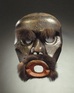 Kwakwaka'wakw. <em>Dzunuk'wa Cannibal Woman Mask</em>, 19th century. Cedar wood, fur (black bear?), hide, pigment, iron nails, 19 1/2 x 14 x 7 3/4 in. (49.5 x 35.6 x 19.7 cm). Brooklyn Museum, Gift of Herman Stutzer, Esq., 15.513.1. Creative Commons-BY (Photo: Brooklyn Museum, 15.513.1_SL1.jpg)