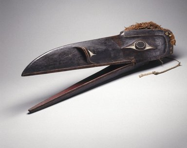 Kwakwaka'wakw. <em>Raven Mask</em>, 1801-1900. Wood, pigment, cedar bark, 11 x 40 x 9 1/2 in. (27.9 x 101.6 x 24.1 cm). Brooklyn Museum, Gift of Herman Stutzer, Esq., 15.513.3a-b. Creative Commons-BY (Photo: Brooklyn Museum, 15.513.3a-b_SL1.jpg)