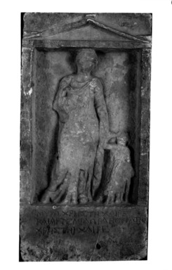 Graeco-Egyptian. <em>Funerary Stela</em>, 4th-3rd century B.C.E. Marble, 9 5/8 × 2 5/16 × 19 in. (24.5 × 5.9 × 48.2 cm). Brooklyn Museum, Gift of Evangeline Wilbour Blashfield, Theodora Wilbour, and Victor Wilbour honoring the wishes of their mother, Charlotte Beebe Wilbour, as a memorial to their father, Charles Edwin Wilbour, 16.106. Creative Commons-BY (Photo: Brooklyn Museum, 16.106_NegA_glass_bw.jpg)