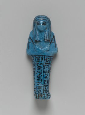 <em>Shabty of Nesi-ta-nebet-Isheru, Daughter of Pinedjem II</em>, ca. 1075-945 B.C.E. Faience, 5 13/16 x 2 1/4 x 1 1/2 in. (14.7 x 5.7 x 3.8 cm). Brooklyn Museum, Gift of Evangeline Wilbour Blashfield, Theodora Wilbour, and Victor Wilbour honoring the wishes of their mother, Charlotte Beebe Wilbour, as a memorial to their father, Charles Edwin Wilbour, 16.183. Creative Commons-BY (Photo: Brooklyn Museum, 16.183_front_PS2.jpg)
